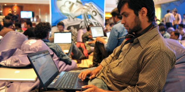 A participant uses his laptop computer during the fifth edition of Open Hack India, a 24-hour non-stop...