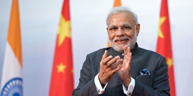 India's Prime Minister Narendra Modi applauds as he attends the opening ceremony for the Centre for Gandhian...