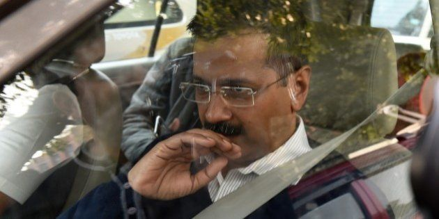 Aam Aadmi Party's Delhi chief minister-designate Arvind Kejriwal arrives for a meeting with Indian Home...