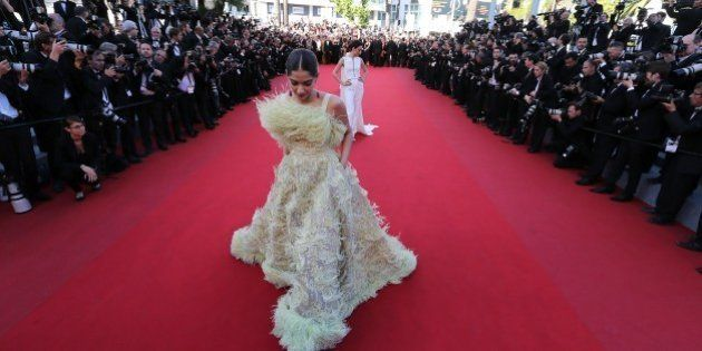 Indian actress Sonam Kapoor poses as she arrives for the screening of the film 'Inside Out' at the 68th...