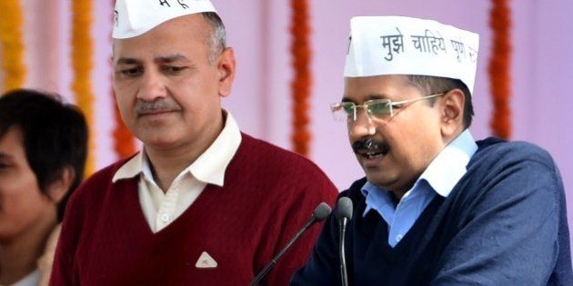 Aam Aadmi Party (AAP) president Arvind Kejriwal (R), with fellow AAP minister Manish Sisodia, addresses...
