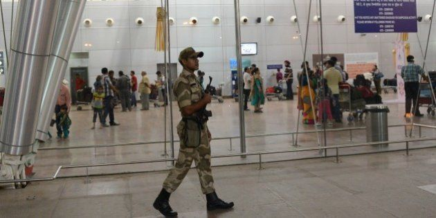 An Indian paramilitary soldier from the Central Industrial Security Force (CISF) keeps vigil at the Sardar...