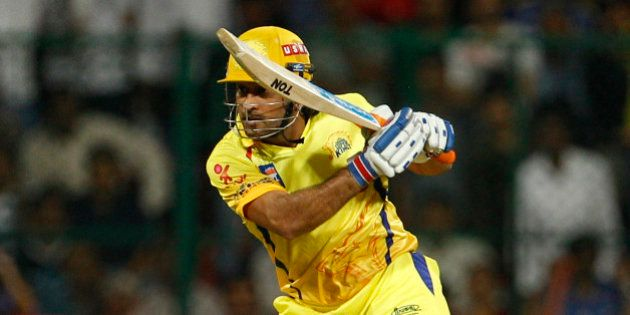 Chennai Super Kings' captain Mahendra Singh Dhoni watches his shot during their Indian Premier League...