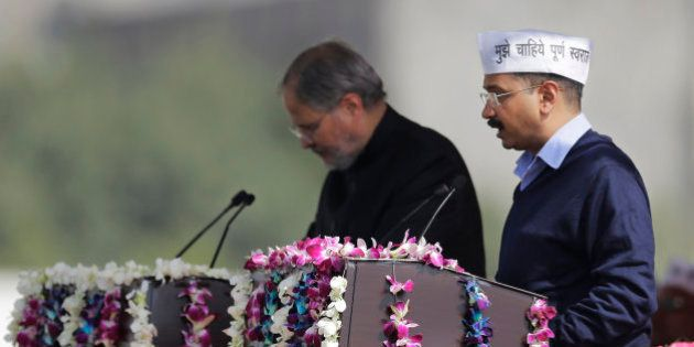 Aam Aadmi Party, or Common Man's Party, leader Arvind Kejriwal takes the oath of office as Delhi's new...