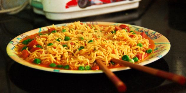 Maggi Noodles Rice Mania, Chili Chow. The peas and sliced chicken sausages are my improvisation ;-)Maggi...