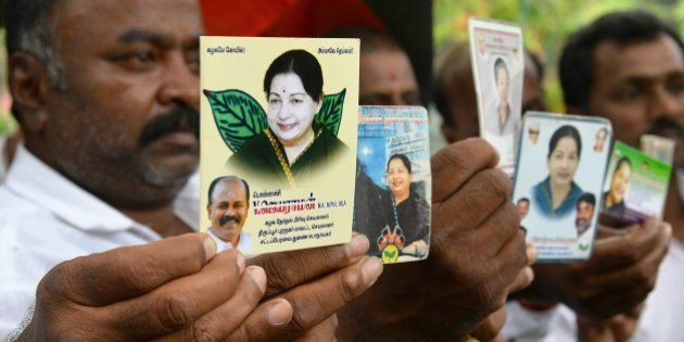 Supporters of All India Anna Dravida Munnetra Kazhagam (AIADMK) supremo, Jayalalithaa Jayaram as they...