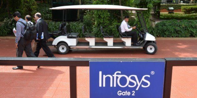 Employees of Infosys walk inside the lush green premises as the company announces its first quarter results...