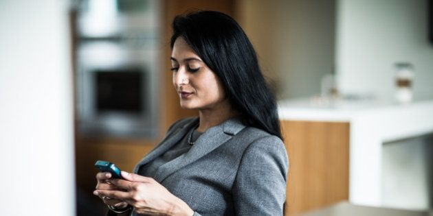 businesswoman using smartphone at