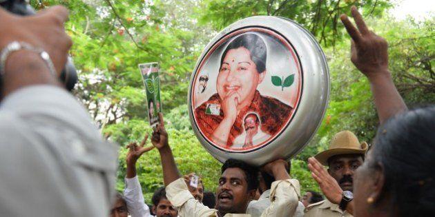 Supporters of All India Anna Dravida Munnetra Kazhagam (AIADMK) supremo, Jayalalithaa Jayaram dance and...