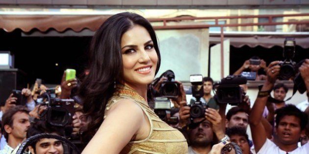 Indian actress and former adult film actress Sunny Leone poses for a photograph during a promotional...