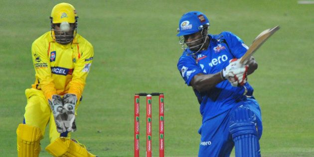 JOHANNESBURG, SOUTH AFRICA - OCTOBER 20: Kieron Pollard of Mumbai hits another six with MS Dhoni of CSK...
