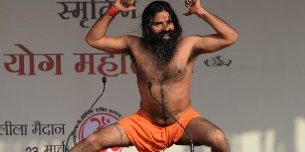 Indian yoga guru Baba Ramdev performs yoga at the 'Yoga Mahotsav' in New Delhi on March 23, 2014. Ramdev...