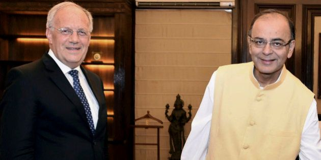 INDIA OUT - Indian Finance Minister Arun Jaitley, right, and Switzerland's Economic Affairs Minister...