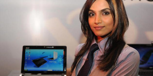 An Indian model poses with the Acer Gatway and eMachines PC during the launch in New Delhi on May 26,...
