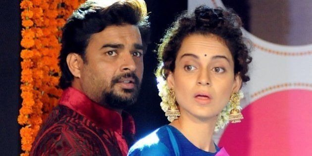 Indian Bollywood actors Kangana Ranaut (L) and R. Madhavan attend a party for the Hindi film Tanu Weds...