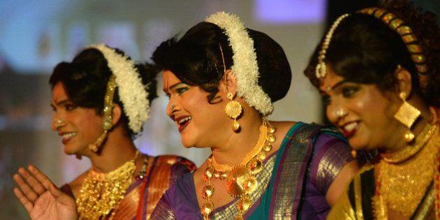Indian transgenders perform at a seminar for the transgender community in Mumbai on October 3, 2013....