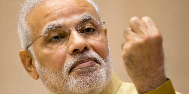 FILE - In this Thursday, Sept. 25, 2014 file photo, Indian Prime Minister Narendra Modi addresses business...