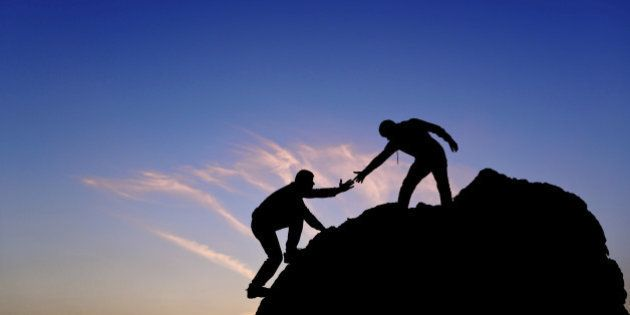 Silhouette of helping hand between two