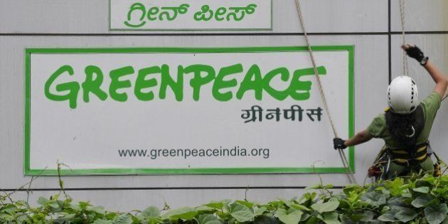 Activists of GreenPeace rappell down their office building where they are head quartered to unfurl banners...