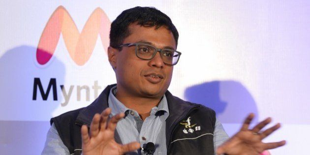 CEO and Co-Founder of Flipkart, Sachin Bansal addresses the media during a press conference to announce...