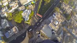 This British Daredevil Hung One-Handed Off A Crane Atop A Bangalore