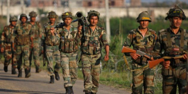 Indian army soldiers return to their camp after an attack by suspected Kashmiri rebels in Samba, about...