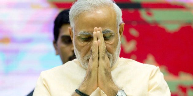 Indian Prime Minister Narendra Modi greets the audience during the launch of a special television channel...
