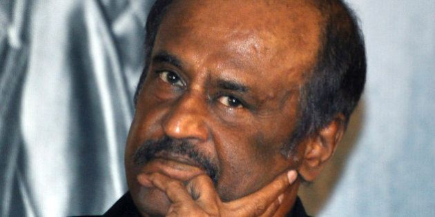 Indian Bollywood actor Rajinikanth poses as he attends a music launch ceremony for the Hindi film 'Robot'...