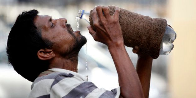 An Indian drinks water from a bottle on a hot summer day in Allahabad, India, Sunday, May 31, 2015. Heat-related...