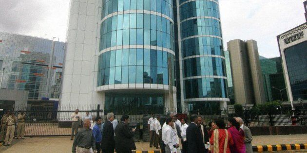 MUMBAI, INDIA: Indian businessmen and women arrive at the opening of the new corporate headquarters of...