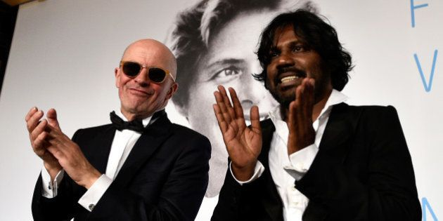 CANNES, FRANCE - MAY 24: (L-R) Director Jacques Audiard and actor Jesuthasan Antonythasan clap after...