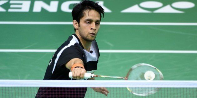 Parupalli Kashyap of India returns a shot to Xue Song of China during the women's singles badminton match...