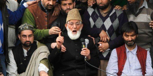 Kashmiri separatist leader Syed Ali Geelani flanked by separatist leaders Yasin Malik, right, and Mirwaiz...