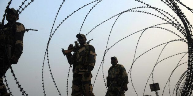 Indian Border Security Force (BSF) personnel patrol the border with Bangladesh, outside the Fulbari Border...