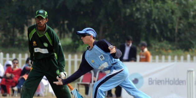 Visually impaired Indian cricketer Ketan Patel (R) bowls during the first one-day international cricket...