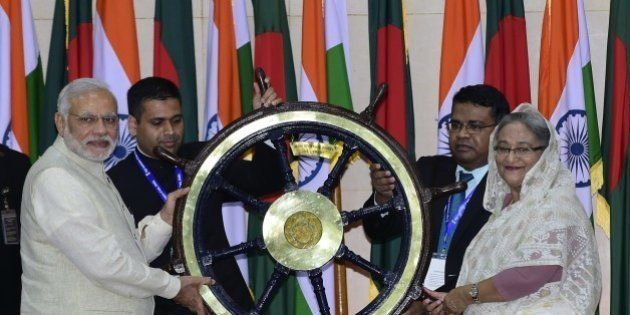 Indian Prime Minister Narendra Modi (L) hands over the steering wheel of INS Vikrant to Sheikh Hasina...