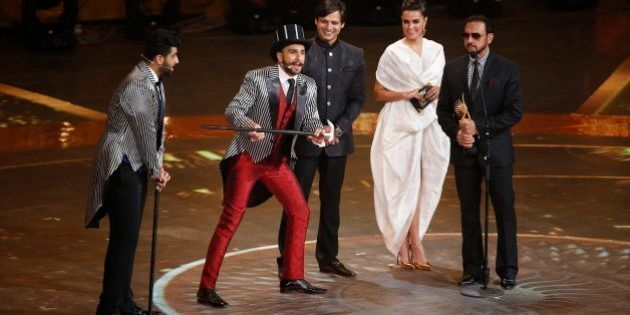 Bollywood actor Ranveer Singh, second left, entertains the audience at the International Indian Film...