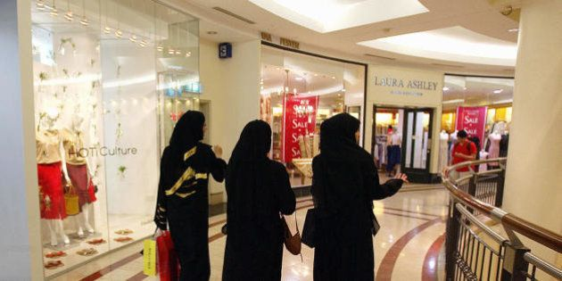 KUALA LUMPUR, MALAYSIA: TO GO WITH AFP STORY MALAYSIA-MIDEST-TOURISM Arab women walk past shopping outlets...