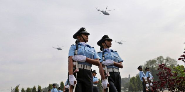 Helicopters fly over new graduates of the Indian Air Force during their passing out parade ceremony in...