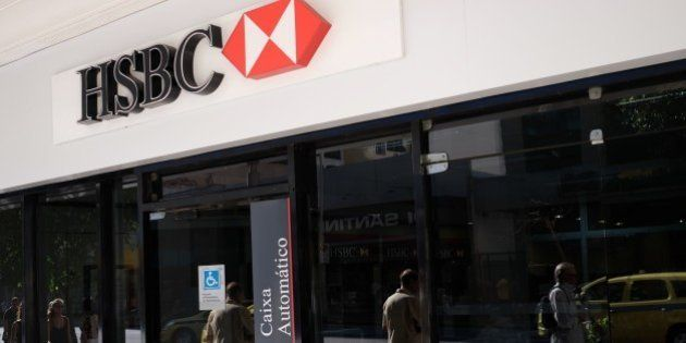 View of the facade of a HSBC bank cash dispenser, following the announcement of the bank to close HSBC...