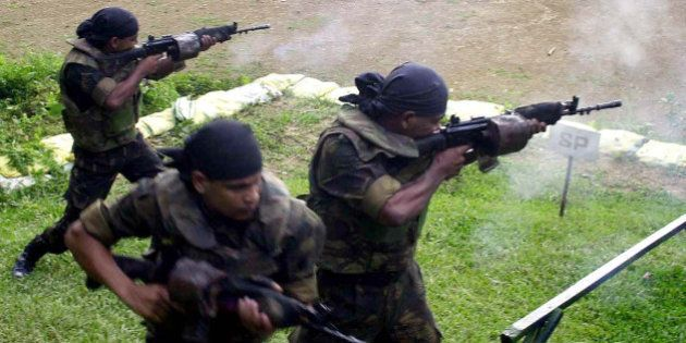 Indian army commandos of Counter Insurgency and Jungle Warfare School (CIJWS) fire during a training...