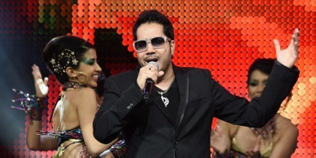 Bollywood singer Mika Singh performs on stage at the Mid Florida Credit Union Amphitheater during the...