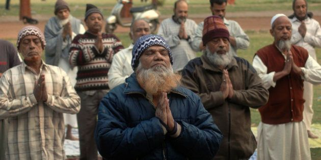 Indian Muslims perform Yoga in Ahmadabad, India, Monday, Dec. 21, 2009. More than fifty Muslim men and...