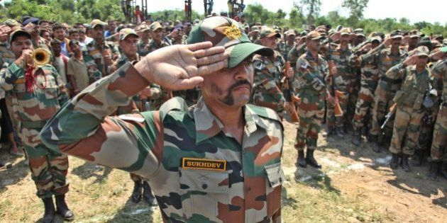 Indian army soldiers pay tribute to their colleague Randeep Singh, who was killed in Thursday's rebel...
