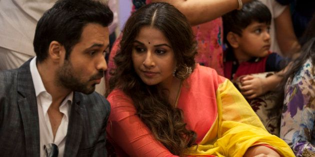 Bollywood actress Vidya Balan, right, listens to actor Emran Hashmi during a promotional event of their...