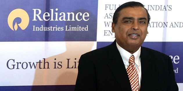 Reliance Industries Chairman Mukesh Ambani poses as he arrives for the company's annual general meeting...