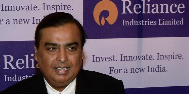 Reliance Industries chairman, Mukesh Ambani poses on his arrival for the company's annual general meeting...