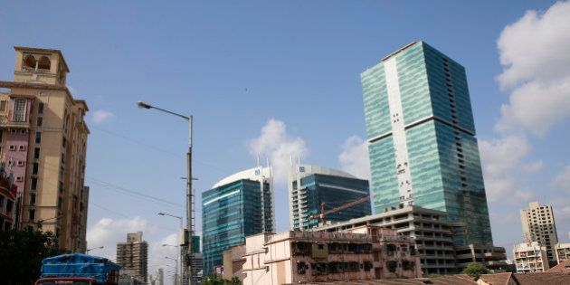 View of new and old buildings is seen at a neighborhood in Mumbai, India, Tuesday, June 2, 2015. India's...