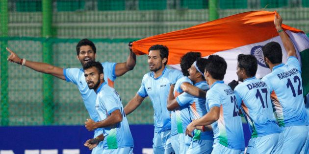India's team celebrate after winning the men's gold medal hockey match against Pakistan at the 17th Asian...