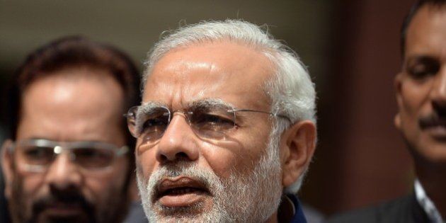 Indian Prime Minister Narendra Modi addresses the media outside Parliament in New Delhi on April 20,...